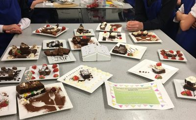 Year 8 pupils are baking brownies
