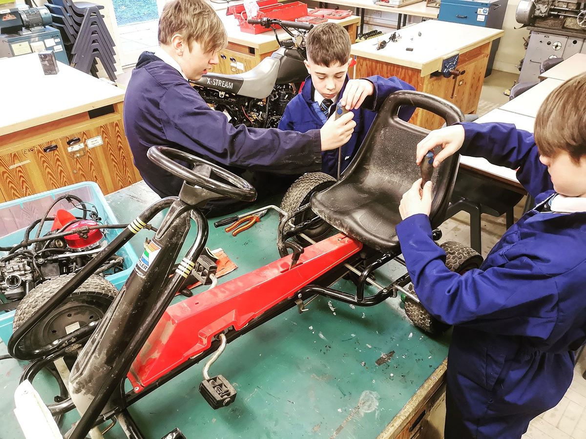 Year 8 pupils work on their cart during their STEM enrichment