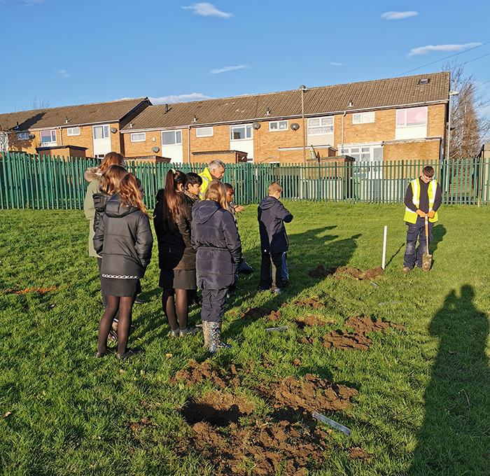 Year 8 pupils planting trees