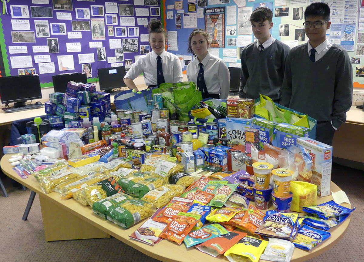 Year 11 Citizenship group with their collection for the homeless