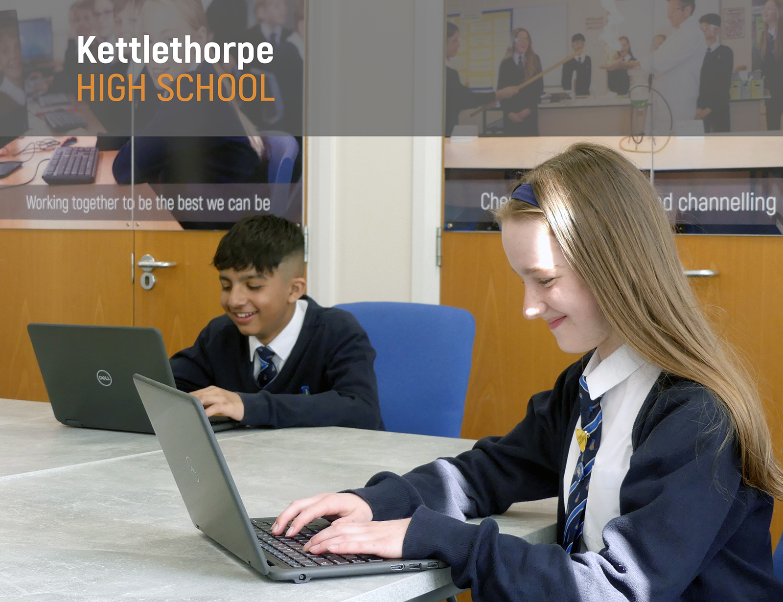 Pupils demonstrate the brand new laptops donated to our school by the local ASDA store